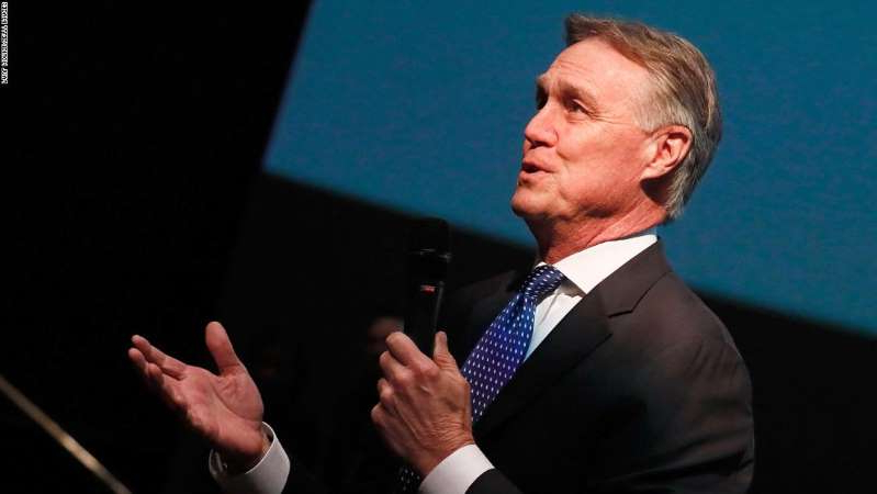 David Perdue wearing a suit and tie: Sen. David Perdue (R-GA) speaks at a special screening of 'Instant Family,' a movie filmed in Georgia.