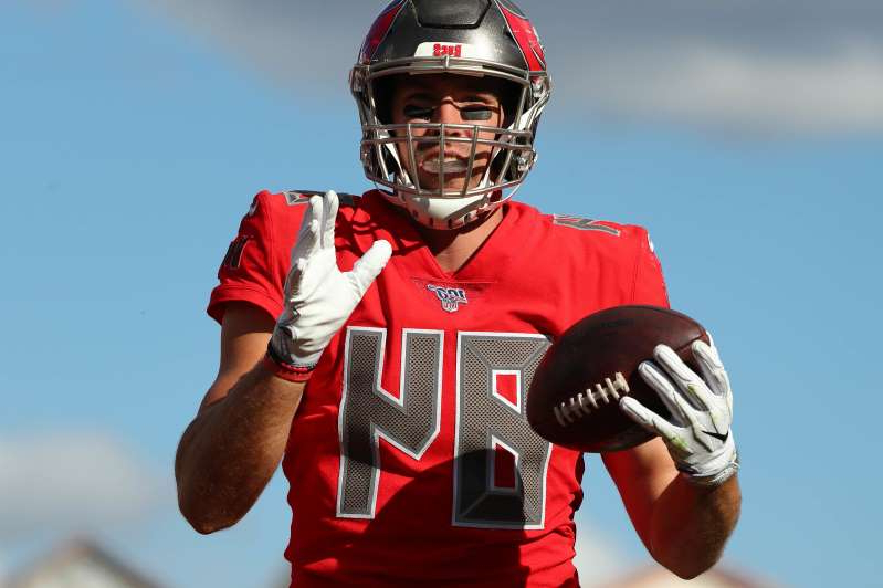 a man wearing a helmet: Tampa Bay Buccaneers tight end Cameron Brate revealed he contracted COVID-19.
