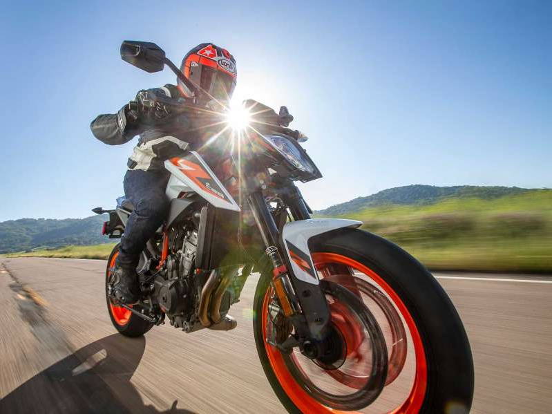 a person riding on the back of a motorcycle: KTM went through great effort in the redesign of its first parallel twin used in the 890 Duke R. Was this for more power or to battle regulatory constraints?