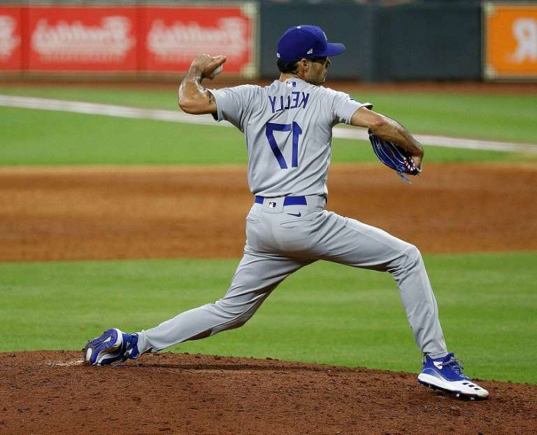 a pitcher throwing a ball at a baseball game: Los Angeles Dodgers reliever Joe Kelly has been banned eight games for his fiery display against the Houston Astros