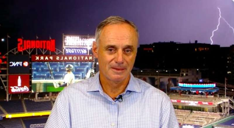 Rob Manfred smiling for the camera