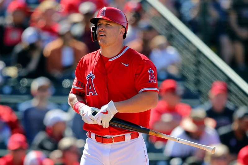 a baseball player holding a bat on a field: The Angels have placed Mike Trout on the paternity list. (Alex Trautwig/MLB Photos via Getty Images)