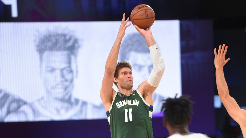 Brook Lopez hitting a ball with a racket: BrookLopez