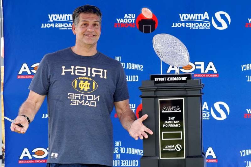 Mike Golic standing in front of a screen: Mike Golic signed off as an ESPN radio host on Friday morning.