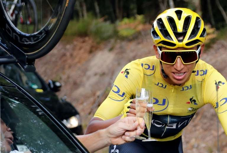 a close up of a person with a helmet on a motorcycle: Colombia's Egan Bernal will defend his Tour title starting August 29
