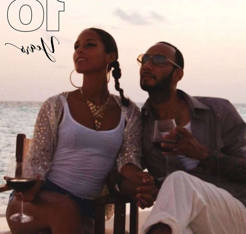 a group of people sitting posing for the camera: Alicia Keys, Swizz Beatz