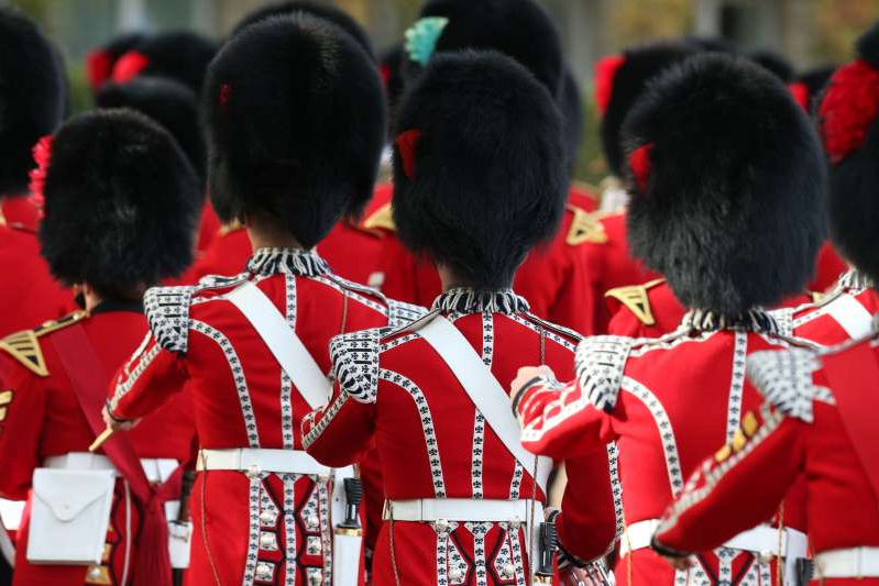 a group of people wearing costumes: Three Coldstream Guards are being investigated by police following the incident, the MoD said (Jonathan Brady/PA)