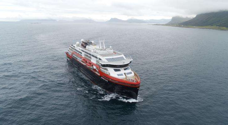 a small boat in a large body of water: Hurtigruten, Roald, Amundsen