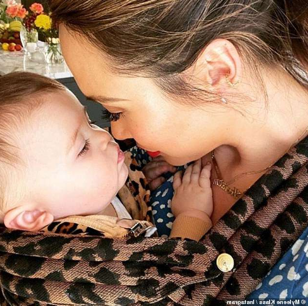 a woman lying on a bed: Celebrations: Myleene Klass was every inch the doting mother as she shared a heartwarming picture of her son Apollo to mark his first birthday on Saturday