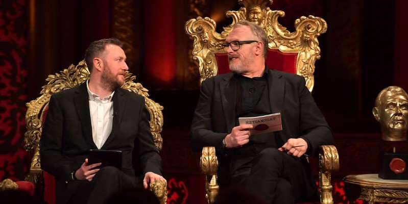 Alex Horne holding a glass of wine: Taskmaster presenters, Greg Davies and Alex Horne reveal who they want on show. Jack Dee would be top of the list due to his behaviour on Celebrity Big Brother.