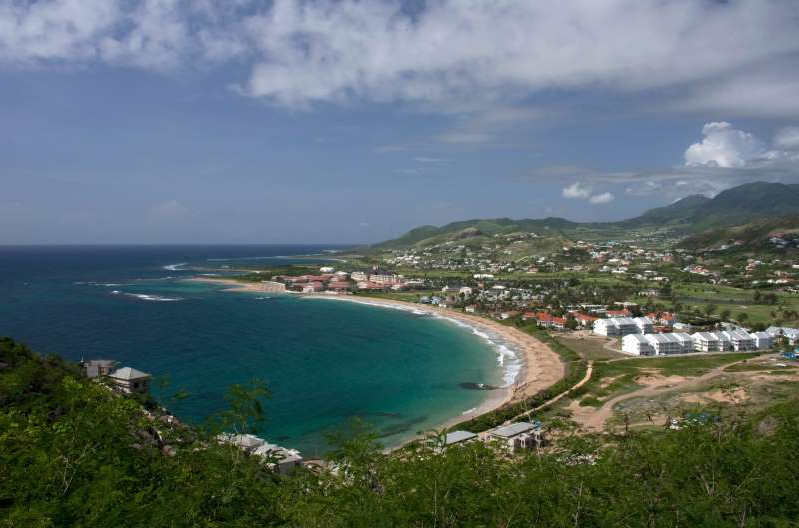 an island in the middle of a body of water: A view of beaches just outside the main capital Basseterre. Reuters