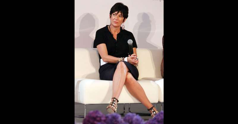 Ghislaine Maxwell sitting posing for the camera