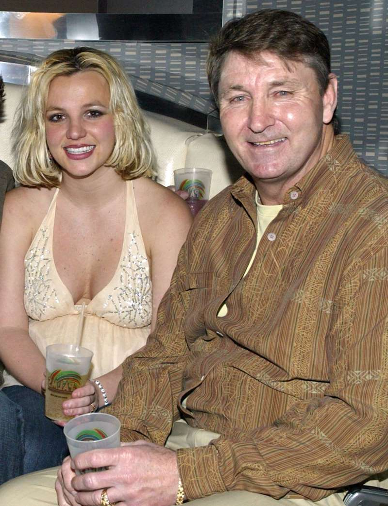 Jamie Spears, Britney Spears posing for the camera: Chris Farina/Corbis/Getty Singer Britney Spears and father Jamie