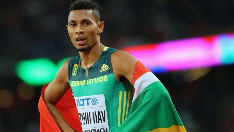 Wayde van Niekerk wearing a blue shirt