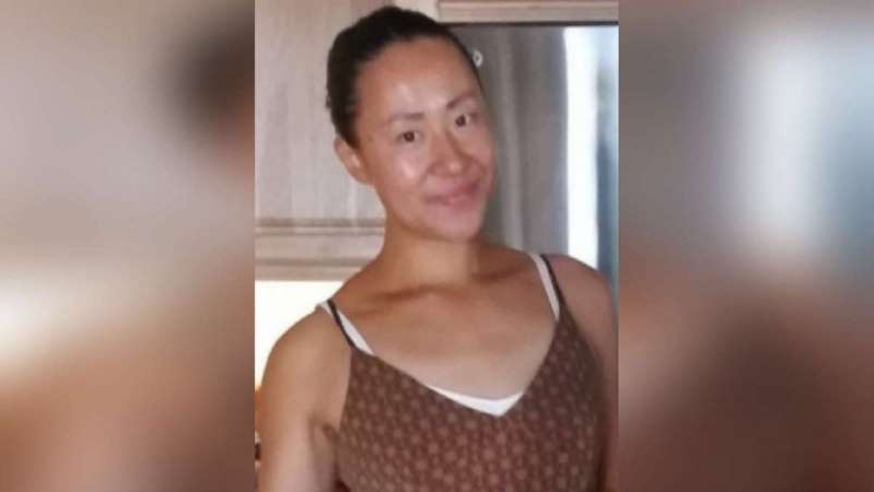 a person standing in front of a mirror posing for the camera: Susie Zhao, 33, a professional poker player also known as Susie Q., was found dead on July 23, 2020, in a parking lot in Lake Township, Mich. A 60-year-old man was taken into custody in relation to her murder on July 31.