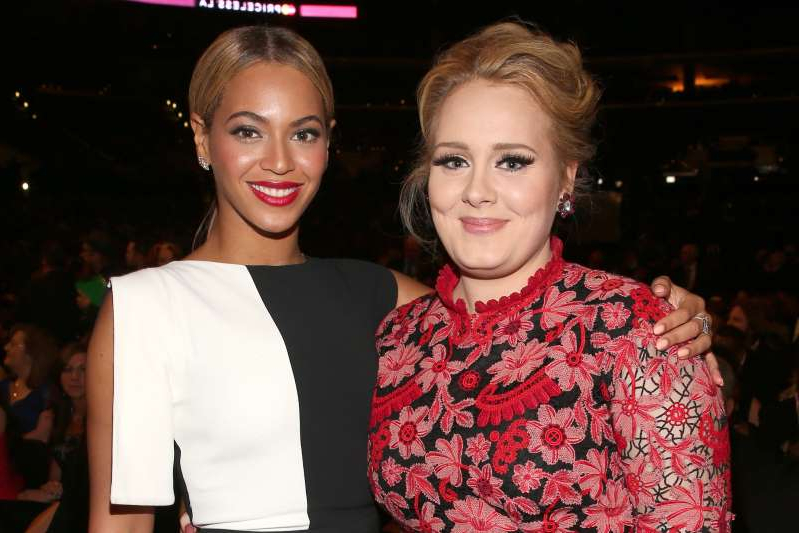 Adele, Beyonce posing for the camera: Adele and Beyonce
