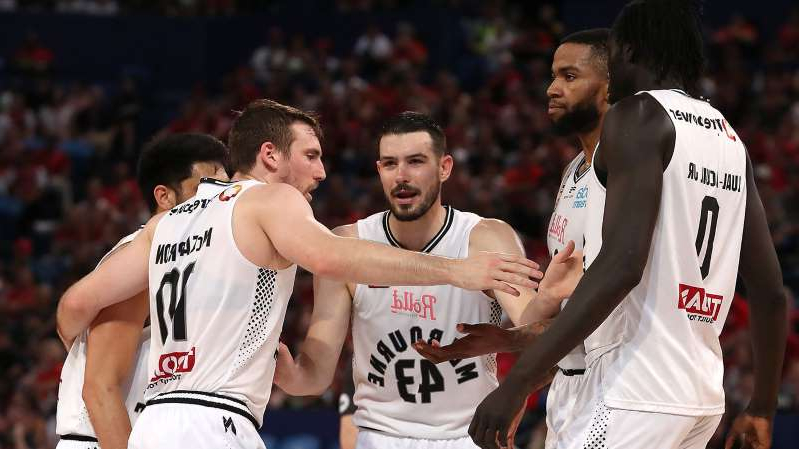 Chris Goulding standing in front of a crowd: Melbourne United 2019