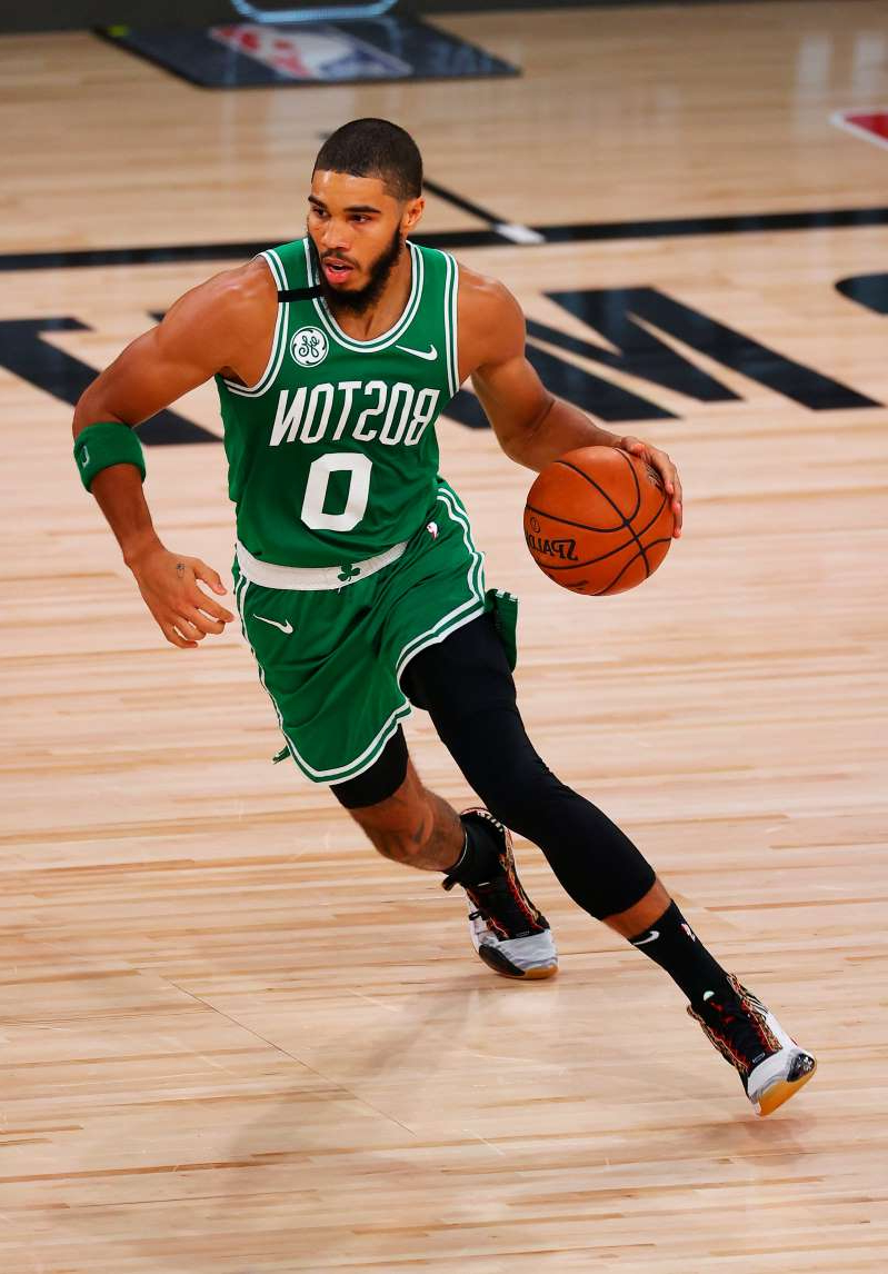 a man with a football ball: Jayson Tatum bounced back from a terrible game Friday with 34 points Sunday for the Celtics.