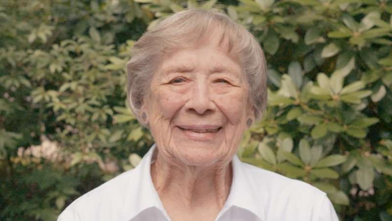 a man smiling for the camera: Judy Parsons is a mother, grandmother and great-grandmother who worked as a codebreaker for the US Navy during World War II.