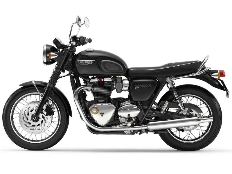 a motorcycle parked on the side of a road: 2020 Triumph T120