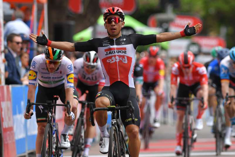 a person riding on the back of a bicycle: Lotto Soudal's Caleb Ewan wins stage 4 of the 2020 Tour Down Under ahead of Irish road race champion Sam Bennett (Deceuninck-QuickStep). Both riders will be among the favourites for the sprinter-friendly 2020 Milano-Torino
