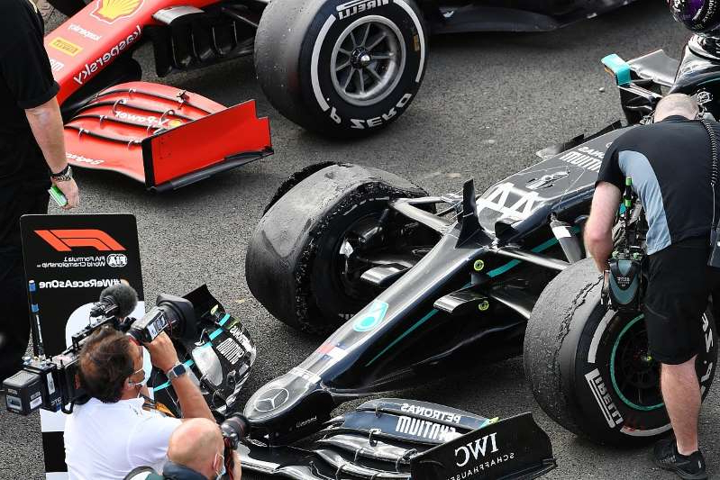 a person sitting on a motorcycle: Mercedes rules out DAS as cause of tyre failures