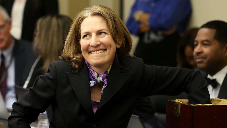 a person wearing a suit and tie: Washington Rep. Kim Schrier wins primary