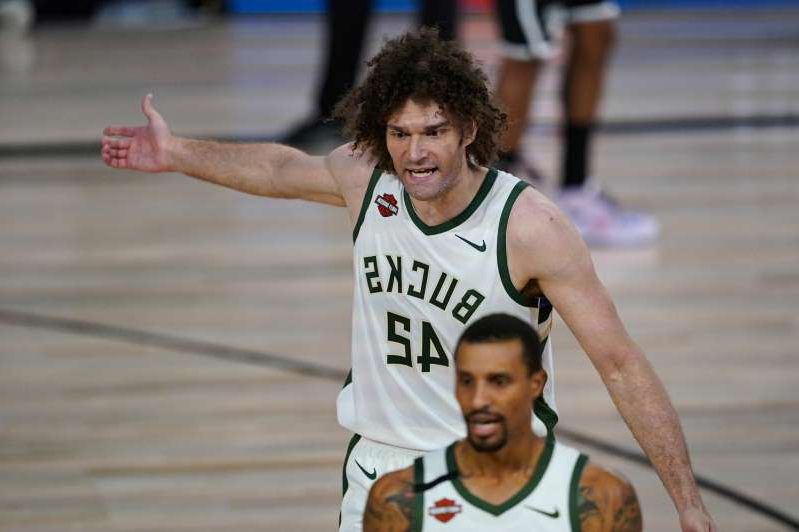 Milwaukee Bucks center Robin Lopez (42) reacts to a call during the first half of an NBA basketball game against the Brooklyn Nets Tuesday, Aug. 4, 2020 in Lake Buena Vista, Fla.