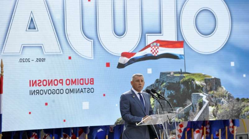 Ante Gotovina et al. standing in front of a truck: Ante Gotovina, a former Croatian general, makes a speech during the ceremony marking the 25th anniversary celebration of Operation Storm in Knin, Croatia [Stipe Majic/Anaoldu Agency]