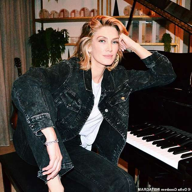 Delta Goodrem sitting on a piano: Negative feedback: Delta Goodrem has revealed she was 'absolutely broken' after being trolled over her 'annoying' behaviour on The Voice