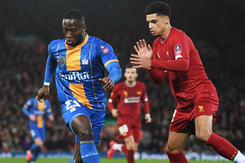 a group of football players on a field: Liverpool FC v Shrewsbury Town - FA Cup Fourth Round: Replay