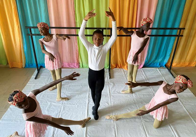 Anthony Mmesoma Madu, an 11-year-old ballet dancer, poses during a rehearsal with other students at the Leap of Dance Academy in Lagos