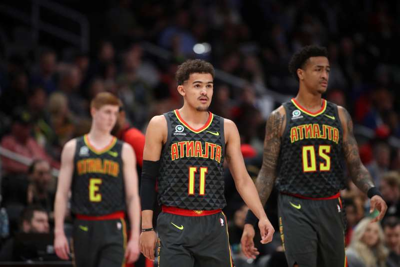 a group of young men playing a game of basketball: Trae Young's Hawks and the other seven teams not in the Orlando bubble are losing ground for next season.