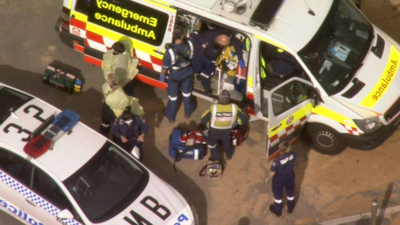 a close up of a toy car: Emergency teams attend to the injured surfer at Sydney's Collaroy Beach.