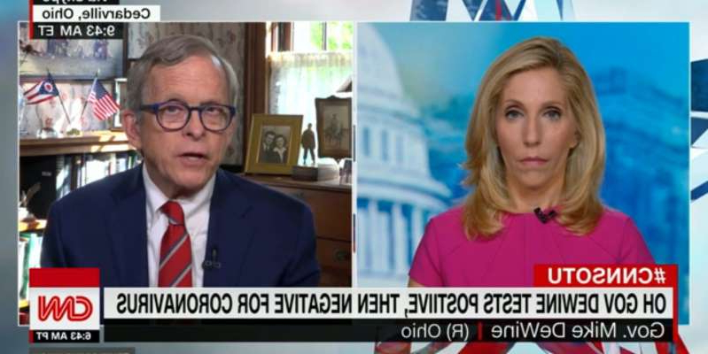 Dana Bash, Mike DeWine are posing for a picture: Ohio Gov. Mike DeWine tested positive for COVID-19 on August 6, but subsequent tests were negative. Screenshot/CNN