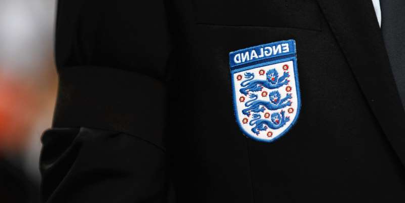 a man wearing a suit and tie: Twenty players who you never knew earned an England call up