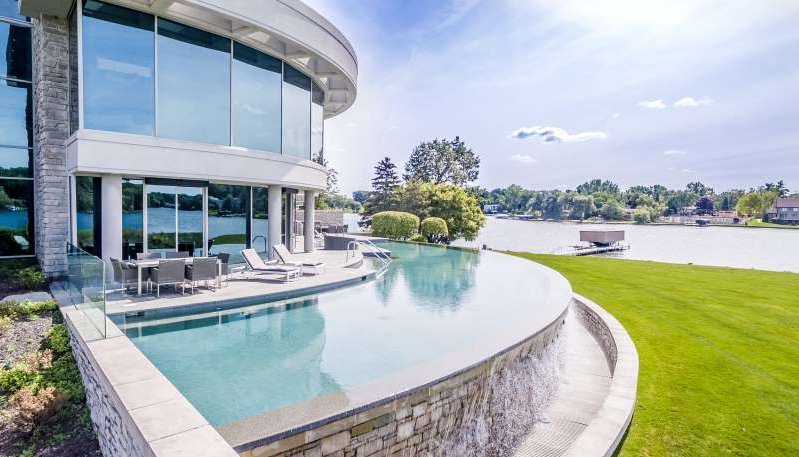 a large pool of water: The home of Detroit Lions quarterback Matthew Stafford at 1867 Long Pointe Drive in Bloomfield Twp. is on sale for $6.5 million. The five-bedroom, seven-bathroom lakefront home features 12,295 square feet, including 7,720 above ground.