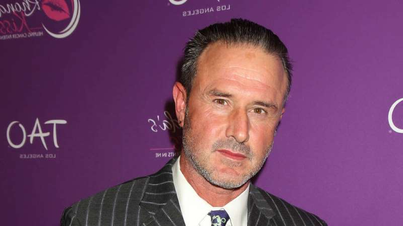 David Arquette wearing a suit and tie