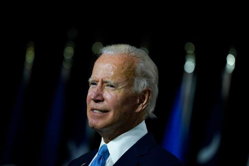 Joe Biden wearing a suit and tie: Biden's campaign referred questions about the fundraisers to the DNC, which didn't respond to a request for comment.