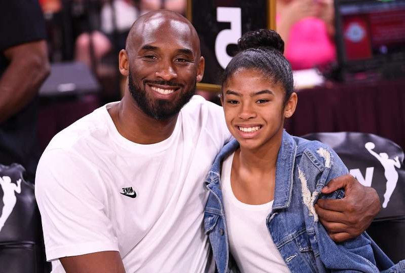 Kobe Bryant et al. that are talking to each other: Kobe and Gianna Bryant at the 2019 WNBA All-Star Game.