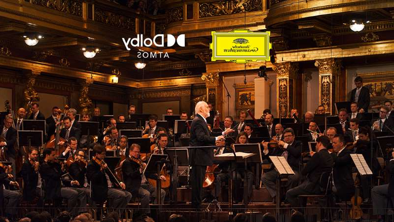 a group of people sitting in front of a crowd: John Williams' Live in Vienna concert gets the Dolby Atmos treatment