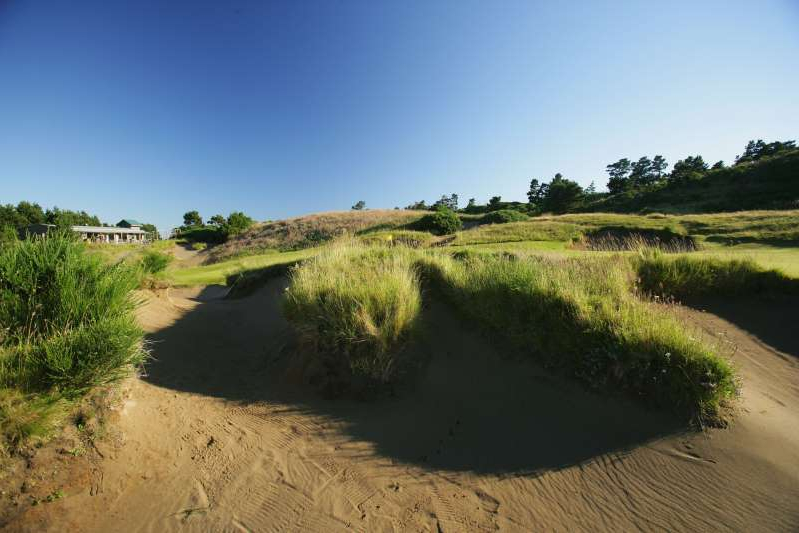 a path with trees on the side of a dirt road: Countless golfers have lost rounds in a bunker, but rarely is it their caddie that does the deed. (Photo by David Cannon/Getty Images)