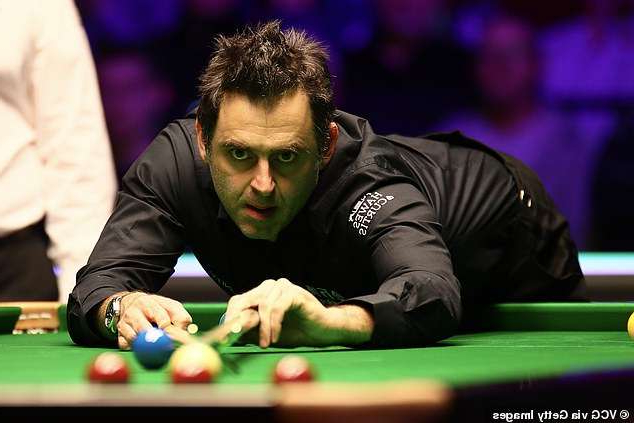 Ronnie O'Sullivan sitting at a table with a ball in a room: Spectators are allowed to attend the final of the World Snooker Championships this weekend