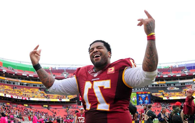 Trent Williams standing in front of a crowd: Getty
