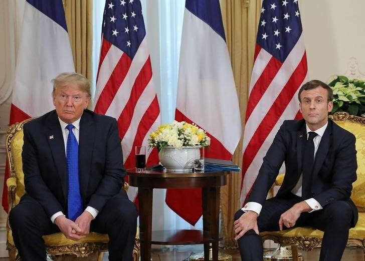 Emmanuel Macron, Donald Trump are posing for a picture: U.S. President Trump meets France's President Macron, ahead of the NATO summit, in London
