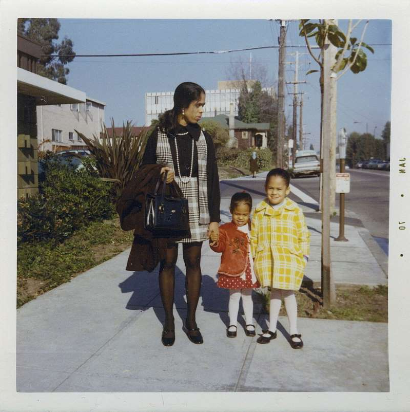 a group of people wearing costumes: This January 1970 photo provided by the Kamala Harris campaign shows her, left, with her sister, Maya, and mother, Shyamala, outside their apartment in Berkeley, Calif., after her parents' separation.
