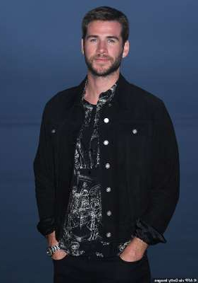 Liam Hemsworth posing for the camera: Not a fan: Liam Hemsworth, 30, developed a 'low opinion' of Miley Cyrus due to how she handled their August 2019 split and her rebounds, according to Us Weekly; shown in June 2019