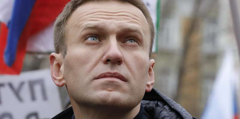 Alexei Navalny wearing a suit and tie: Russian opposition leader Alexei Navalny attends a rally in Moscow, Russia, on February 24, 2019. Reuters