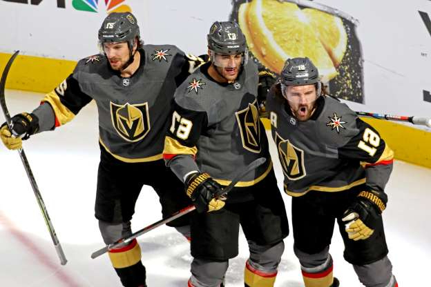 Slide 1 of 40: Aug. 18: The Vegas Golden Knights' Mark Stone (61) celebrates scoring a goal with teammates Max Pacioretty (67) and Shea Theodore (27) during the second period against the Chicago Blackhawks in Game 5 of their playoff series at Rogers Place. The Golden Knights won the game, 4-3, to win the series, four games to one.