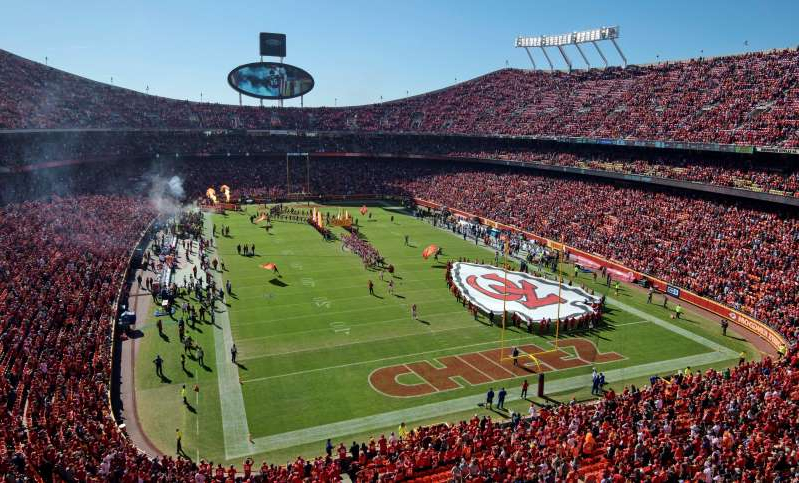 a large stadium with green grass: The Chiefs will no longer allow fans to wear headdresses or Native American-themed face paint inside Arrowhead Stadium. (AP/Reed Hoffmann, File)